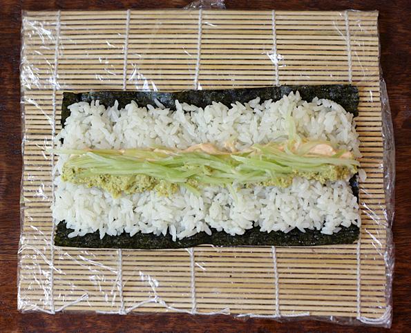 Making edamame sushi roll