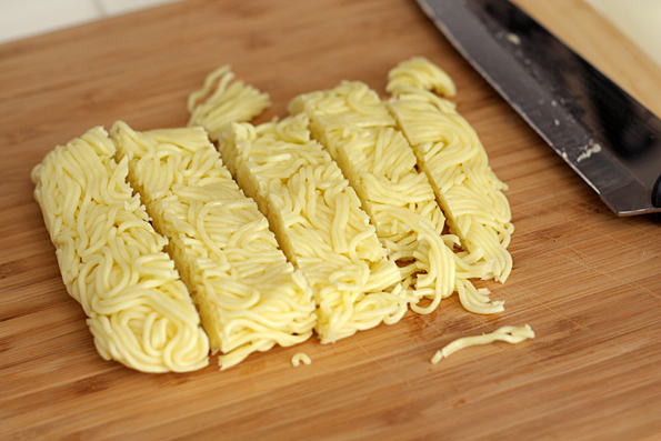 Cut noodle block into slices