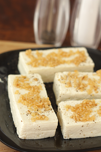 Spread the garlic on the tofu slices