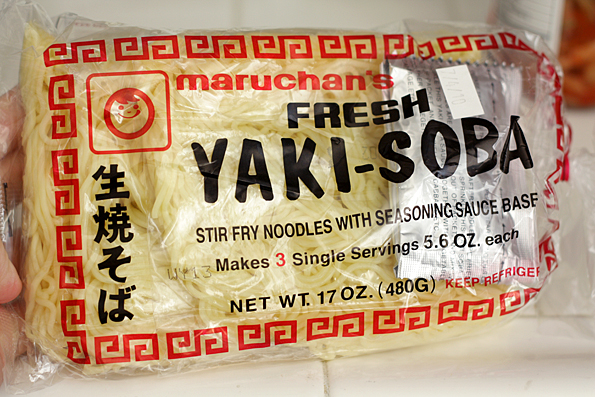 To prepare the yakisoba noodles you take the block of noodles and cut ...