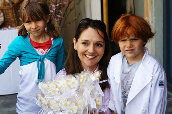 Lucy of Edible Los Angeles with her kids and the cookie pops they made