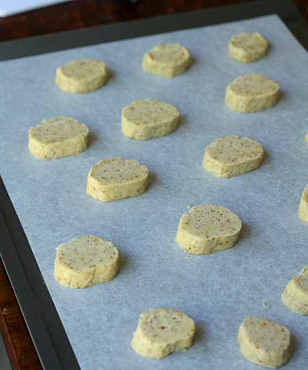 Cookie dough cut into slices and placed on parchment paper lined cookie sheets