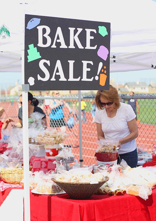 Fuji Nana helping set up the bake sale booth