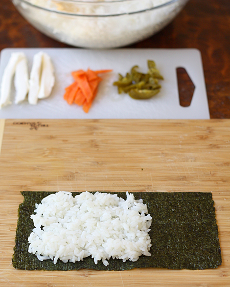 Spread sushi rice on left side of nori