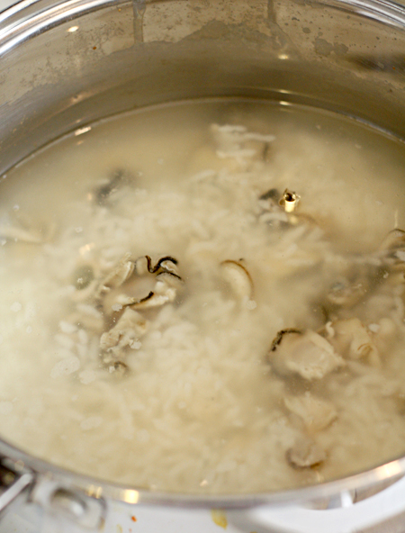 Kaki Zosui cooking in a pot