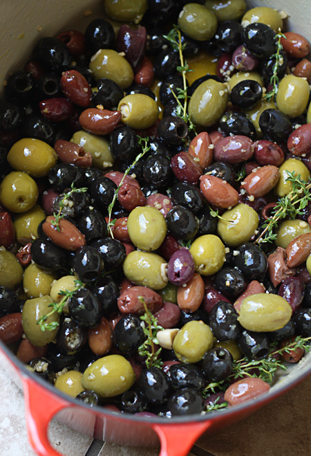 Olives mixed with spices ready to go into the oven