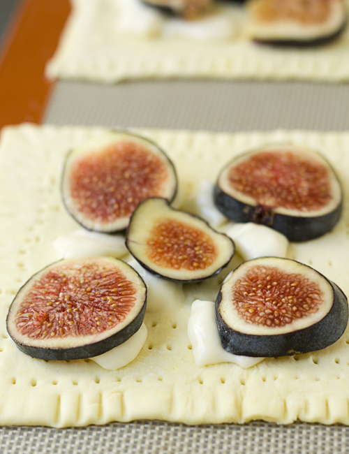 Top the puff pastry squares with bits of brie and sliced figs