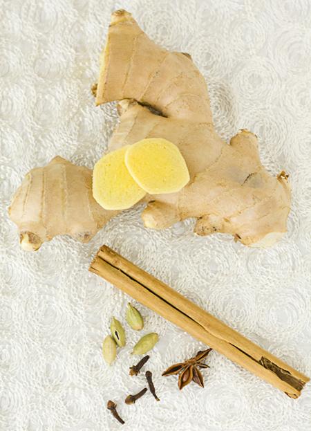 Fresh ginger, cinnamon, green cardamom pods, cloves, and star anise
