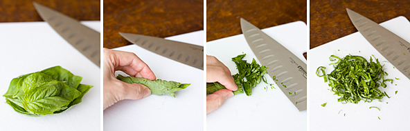 Thinly slicing the fresh basil
