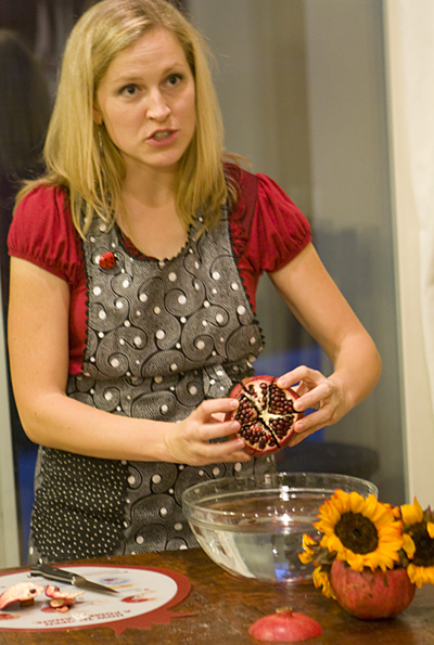 Demonstrating how to open a pomegranate