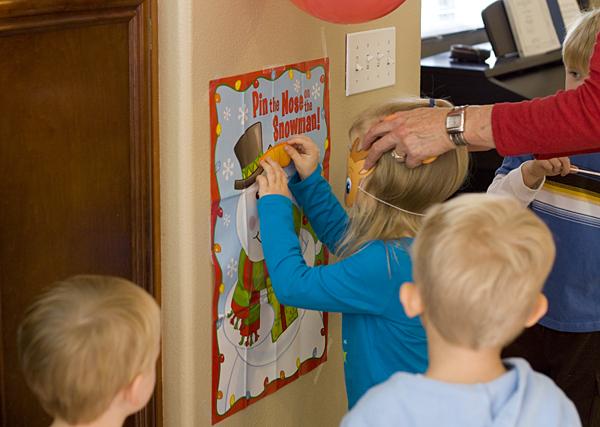 Playing Pin the Nose on the Snowman