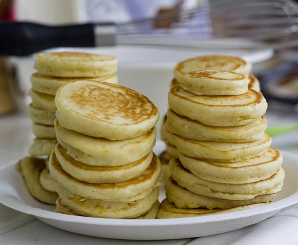 Stacks of mini orange mochi pancakes