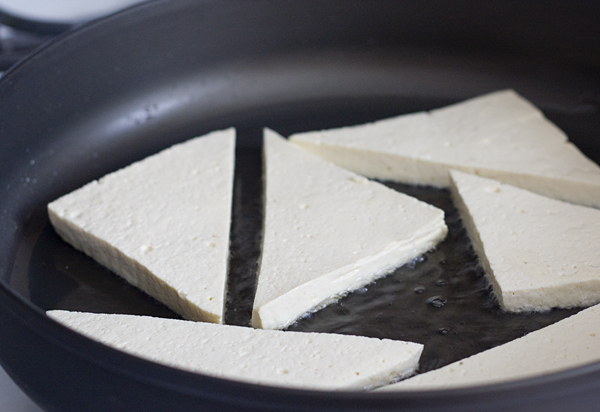 Frying the tofu triangles