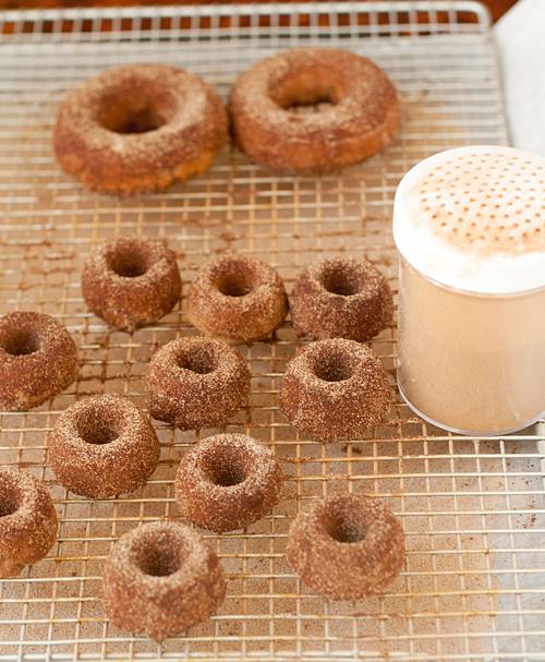 Coating the tofu donuts with cinnamon and sugar