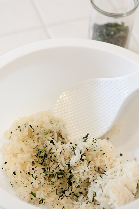 Folding dau miu furikake into steamed rice