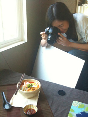 Bee getting a shot of her amazing laksa