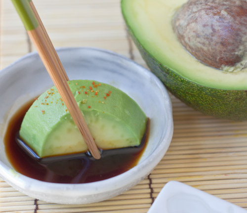 Dip the avocado in soy sauce