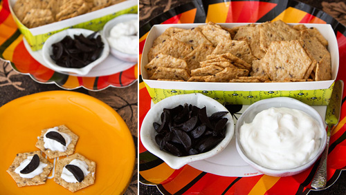 Crackers with kefir cheese and black garlic