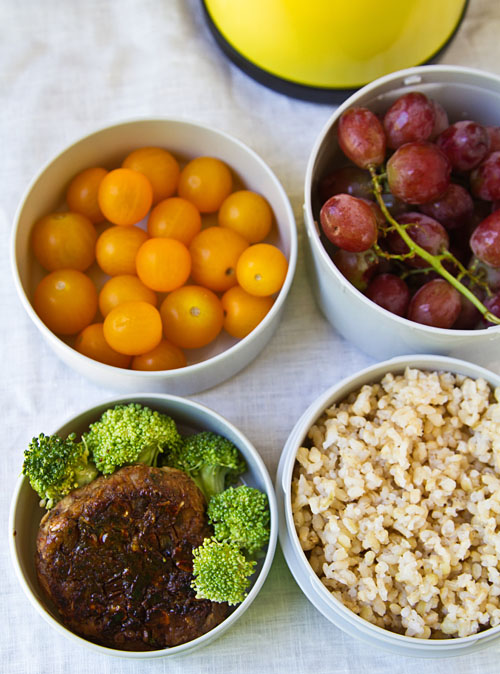 Mr. Bento filled with Vegetarian burger with brown rice, fresh fruit, and veggies