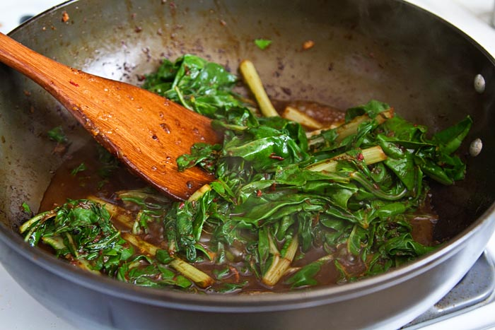 Making stir-fried Asian greens