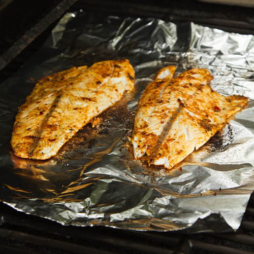 Grilling barramundi fillets