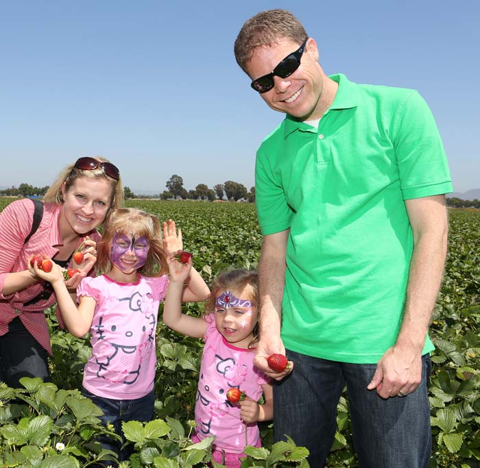 The Fuji family in a strawberry field