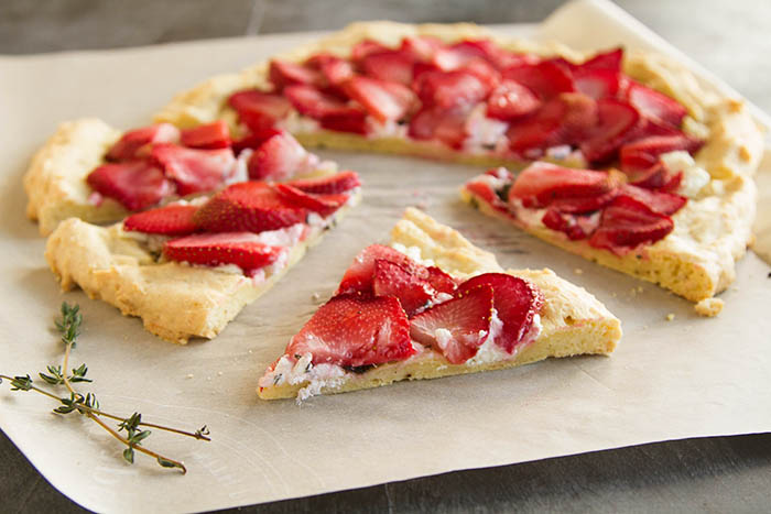 A slice of strawberry chevre flatbread pizza