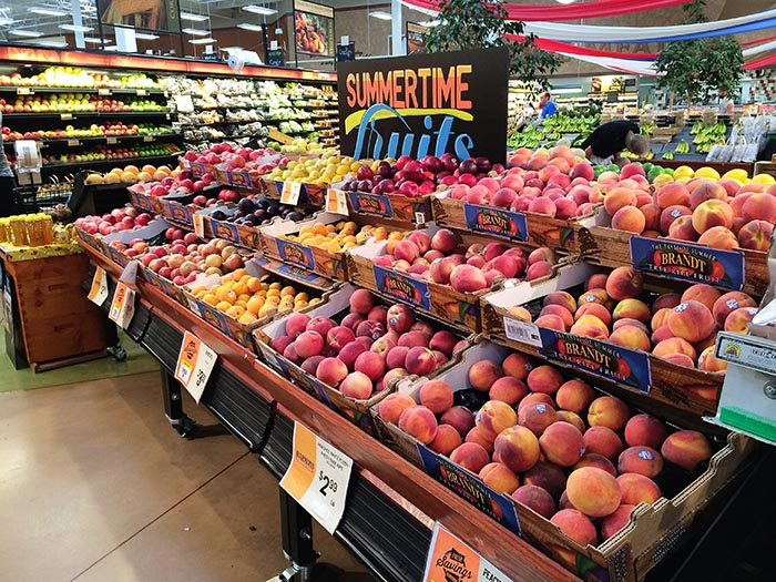 Buying fruit at Harmons Grocery Store