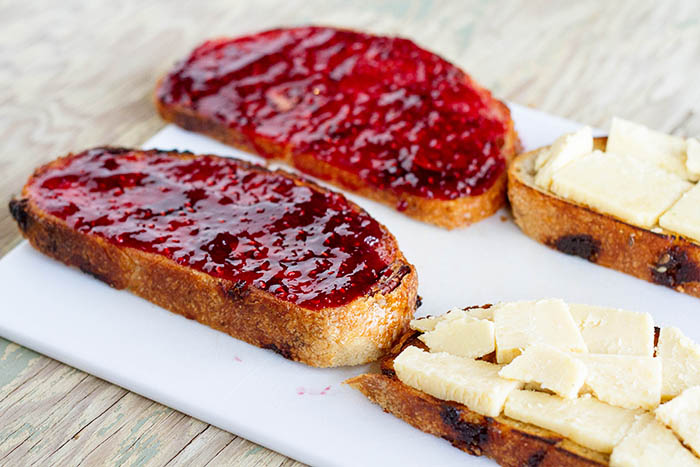 Making grilled cheese sandwiches with jam