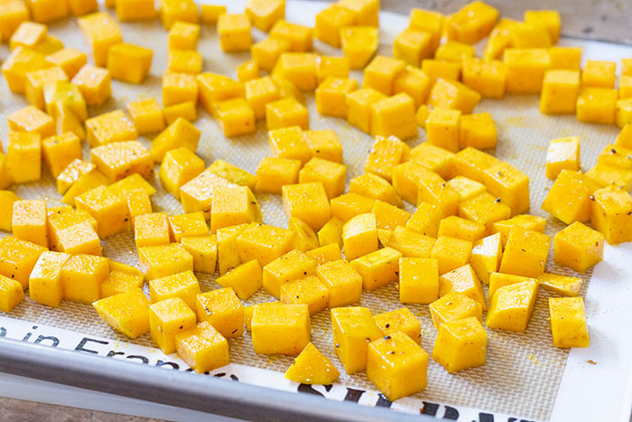 Cubed butternut squash ready for roasting