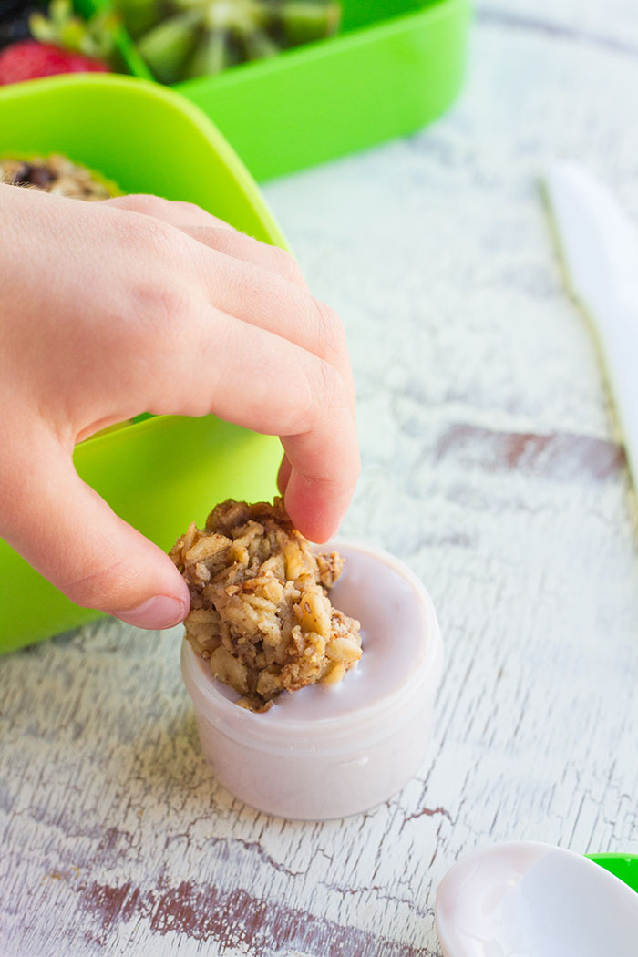 Dipping a Baked Granola Oatmeal Cup into yogrut