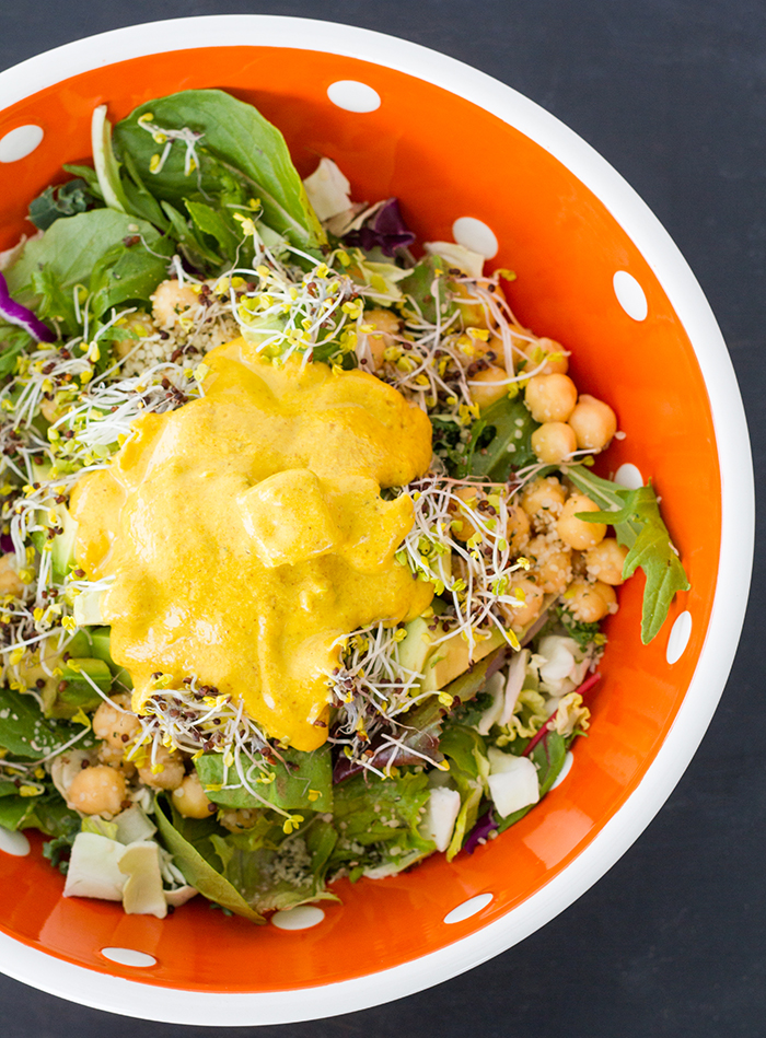Our favorite lunchtime salad with almond butter turmeric dressing