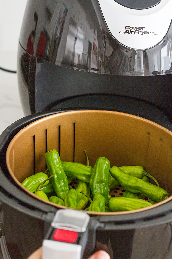 Air-frying shishito peppers