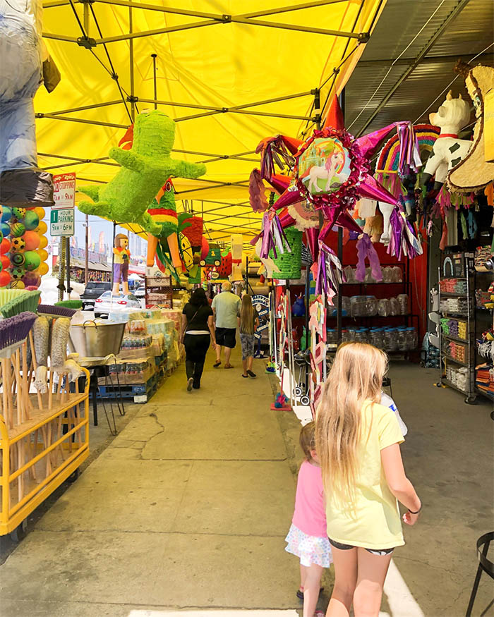 Checking out the pinatas in the Pinata District