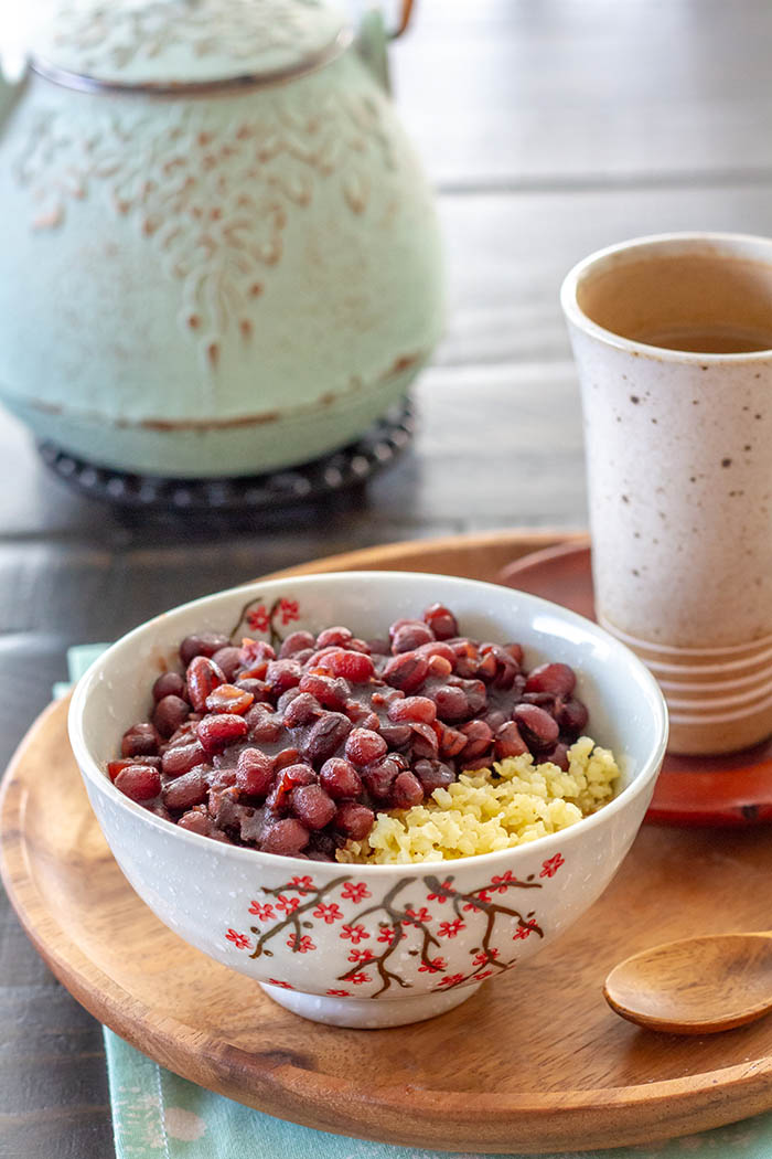 A bowl of ozenzai, a Japanese sweet red bean soup dessert, with cooked millet.