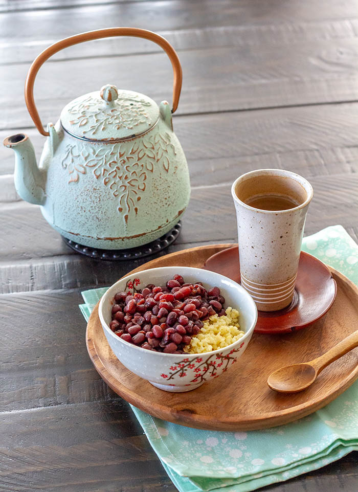 Bowl of Japanese sweet red bean soup with a japanese tea kettle