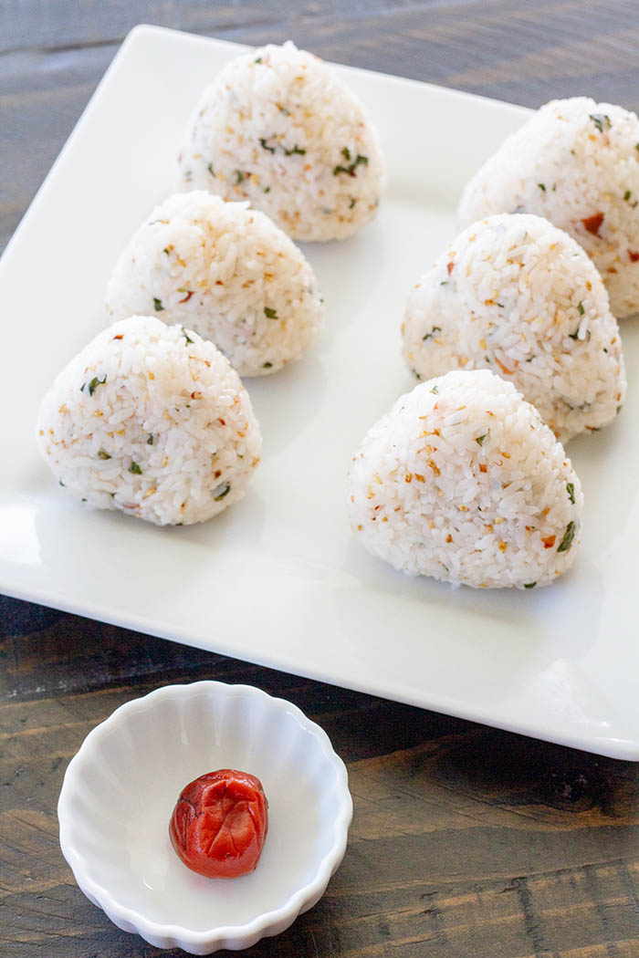 Japanese rice balls made with umeboshi gohan (pickled plum rice)